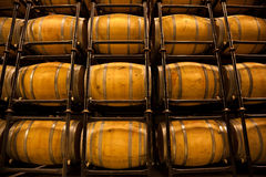 Wine barrel pile in an aging cellar Royalty Free Stock Images