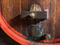 Wine barrel stacked in the old cellar of the winery close up. Stock Images