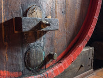 Wine barrel stacked in the old cellar of the winery close up. Royalty Free Stock Photography
