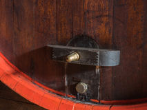 Wine barrel stacked in the old cellar of the winery close up. Stock Photos