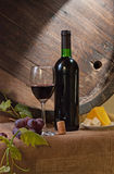 Wine barrel. Still life with wine barrel, bread and cheese royalty free stock image