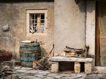 Wine barrel and stone bench in front of an old house in Valun. Island Cres, Croatia Royalty Free Stock Photos