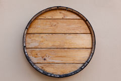 Wine barrel top. Old wine barrel top on old pink wall stock photography