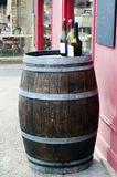 Wine barrel with wine bottles on top Stock Photography