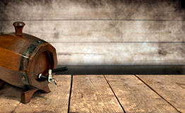 Wine barrel on wooden table. And background royalty free stock image