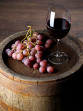 Wine with barrel. On wooden table royalty free stock photo