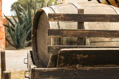 Wine barrel. Wooden texture. Cactus in the back. Old wine barrel. Wooden texture. Cactus in the back. Retro image stock image