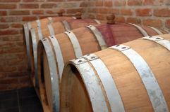 Wine barrels. Perspective of barrels in wine cellar Royalty Free Stock Photos