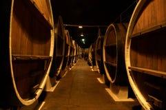 Wine barrels. Row of Wine barrels in wine cellar Royalty Free Stock Images