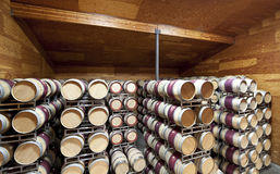 Wine Barrels. A large warehouse of wine barrels in a controlled cellar Stock Images
