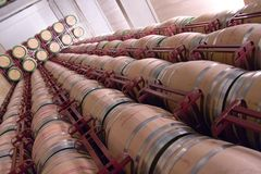 Wine Barrels. Interesting view of countless rows of wine barrels Stock Photos