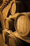Wine barrels. Stacked in the old cellar of the winery Stock Images