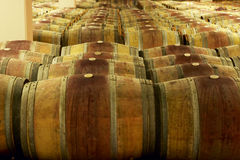 Wine barrels in an aging cellar Stock Photo