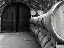 Wine Barrels and Arched Door Stock Photo