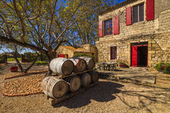 Wine barrels in the background of an ancient house. France. Royalty Free Stock Photos
