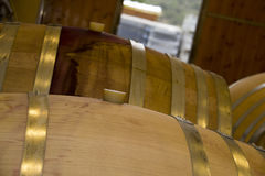 Wine barrels with bung stacked in cellar area of vinery Stock Photography