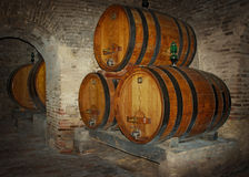Wine barrels on cave Stock Photography