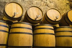Wine barrels in cellar. Wine storage place.  Royalty Free Stock Photography