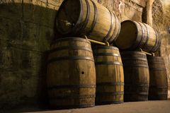 Wine barrels in cellar. Wine storage place.  stock image