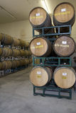 Wine Barrels In Cellar Of Winery Stock Photo
