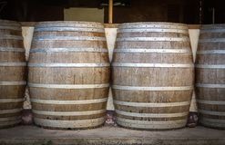 Wine barrels in the cellar of the winery. Wine barrels in wine vaults Stock Photography