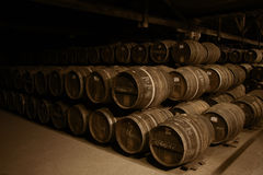 Wine barrels. In a dark old cellar Royalty Free Stock Photography