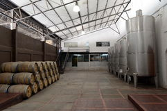 Wine barrels and fermentation tanks at the winery Viu Manent. Royalty Free Stock Photos