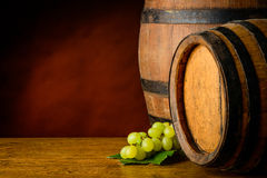 Wine barrels and grapes Stock Photos