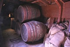 Wine barrels. Old wine barrels in the bottom of a sailing boat in Spain Andalusia royalty free stock photography