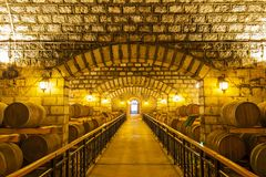 Wine barrels stacked in the cellar. Of the winery stock photo