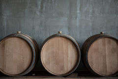 Wine barrels. Stacked in the cellar of the winery royalty free stock photos