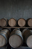 Wine barrels. Stacked in the cellar of the winery Royalty Free Stock Image