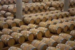 Wine barrels stacked in the cellar of the winery. Royalty Free Stock Photos