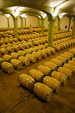 Wine barrels stacked in the cellar of the winery. Royalty Free Stock Image