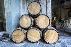 Wine barrels stacked. In the old cellar of the winery Royalty Free Stock Photos