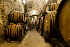Wine barrels stacked. In the old cellar of the winery. Italy royalty free stock photography