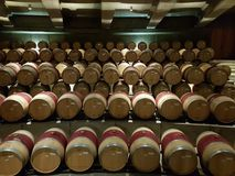 Wine barrels ageing at winery cellar royalty free stock photos
