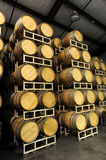 Wine barrels stacked in winery side Royalty Free Stock Photo