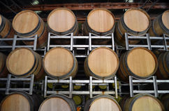 Wine barrels in storage at a winery. Front view of wine barrels in storage at a winery in the Adelaide Hills, South Australia Stock Images