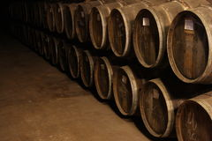 Wine barrels in Vineyard cellar. A stack of old wine barrels in a vineyard cellar Stock Photo