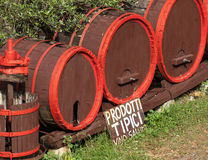 Wine barrels with wine press in outdoor field Stock Photos