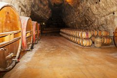 Wine barrels in a winery, France. Wine barrels in a winery, south France Royalty Free Stock Photography
