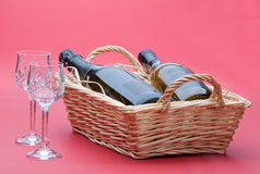Wine in basket Stock Photos