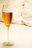 Wine in Bed Royalty Free Stock Image