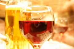 Wine and beer are already here. Half-full glasses of beer and wine Royalty Free Stock Images
