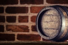 Wine beer cognac whiskey or rum barrel on wooden table.  royalty free stock photo