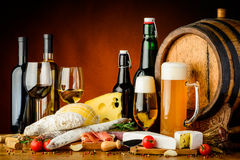 Wine, beer and food. Still life with wine, beer, traditional food, cheese and sausages stock photos