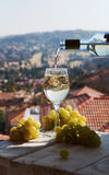Wine being poured into a glass. On a background of mountains Royalty Free Stock Images