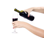 Wine being poured into wine glass. Red wine being poured into wineglass Stock Photo