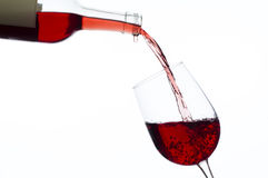 Wine being poured into wineglass Royalty Free Stock Image